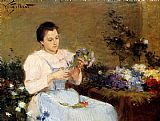 Victor Gabriel Gilbert Arranging Flowers For A Spring Bouquet painting