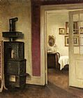 Carl Vilhelm Holsoe An Interior with a Stove and a View into a Dining Room painting