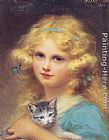 young girl on a Framed Prints - Portrait of a young girl holding a kitten