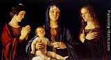 Giovanni Bellini Virgin And Child Between St. Catherine And St. Mary Magdalen painting