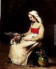 Theodule Augustine Ribot A Girl Arranging A Vase Of Flowers painting